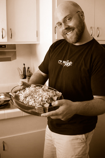 Eric_with_enchiladas_sepia_1